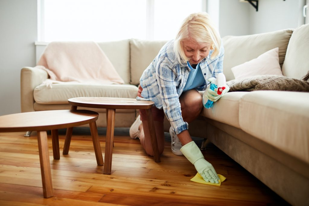 House cleaning worker wiping floor with napkin