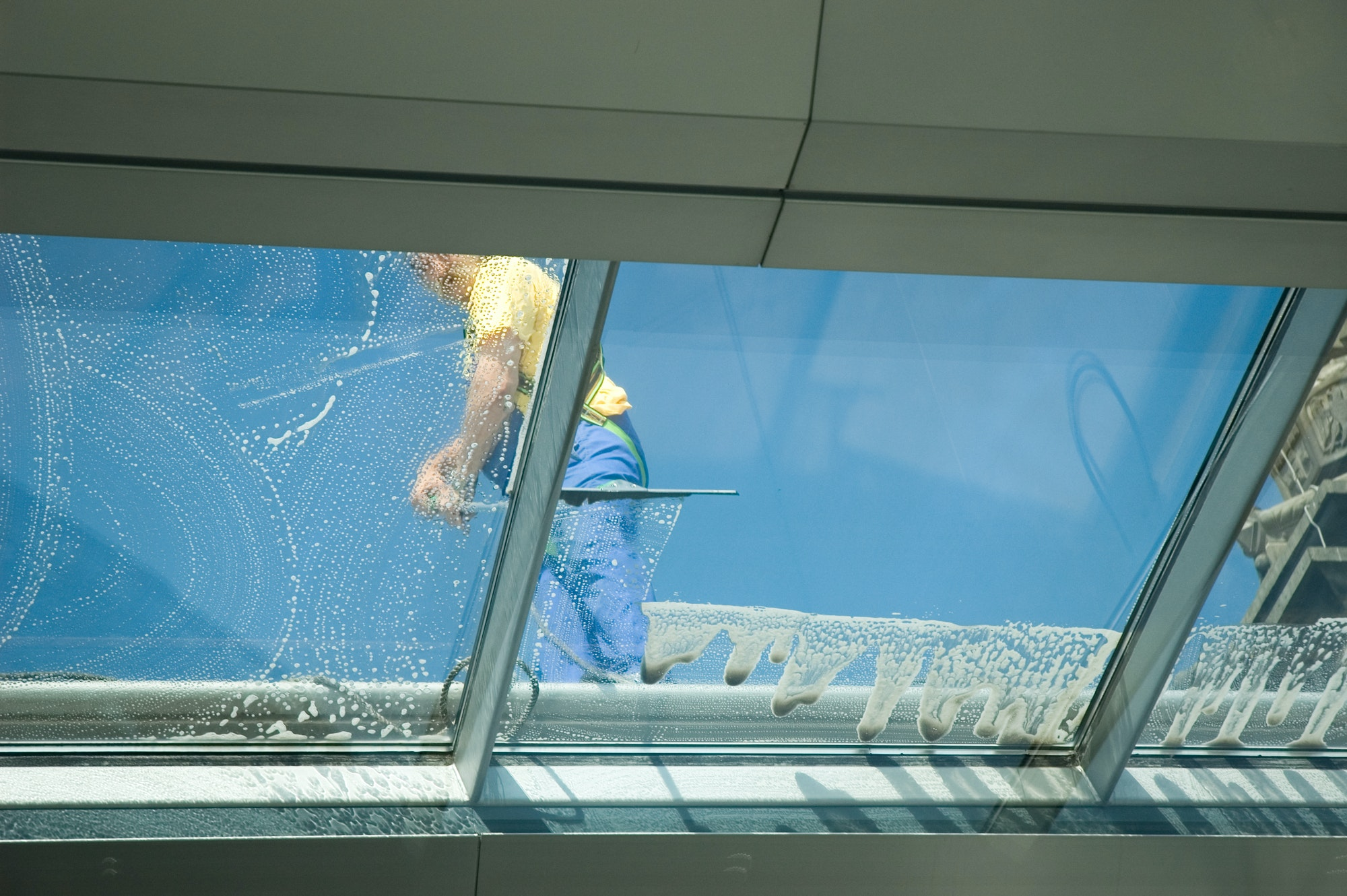 worker cleaning windows
